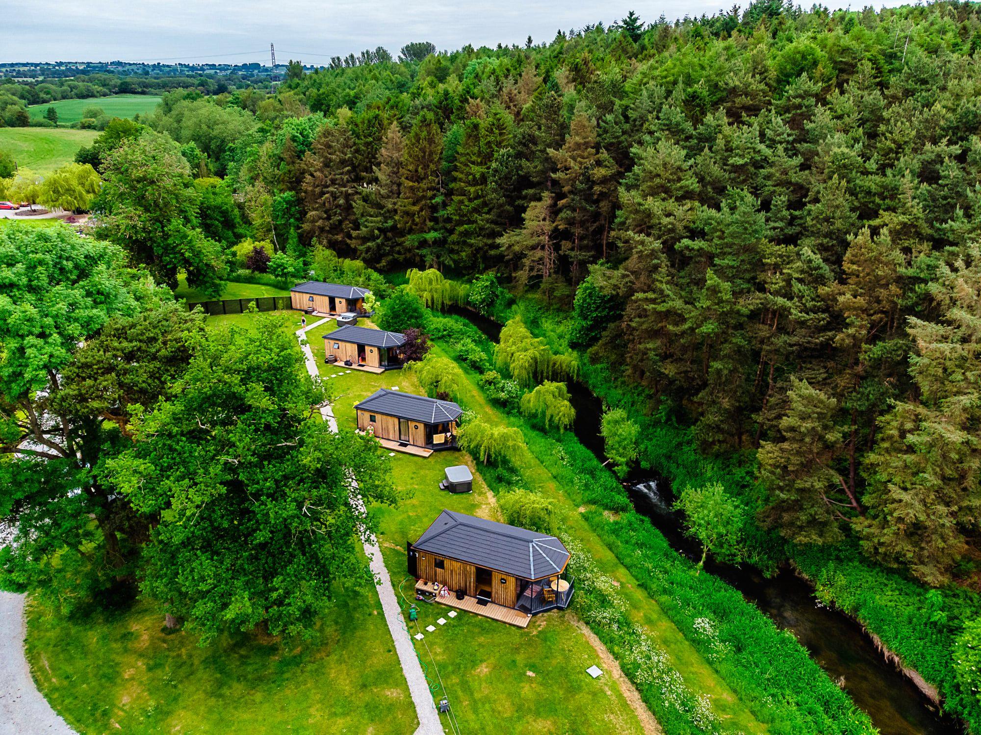 Birds eye view of riverside cabins